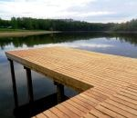 A wooden deck with a relaxing view by the popular walking trail around the Hostivař Reservoir
