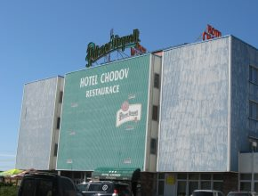 View of the Hotel Chodov Praha building from the driveway entering the free parking lot